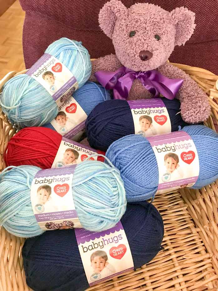 Baby Hugs Medium Premium Acrylic Yarn comes in 26 different colors, both solid and variegated