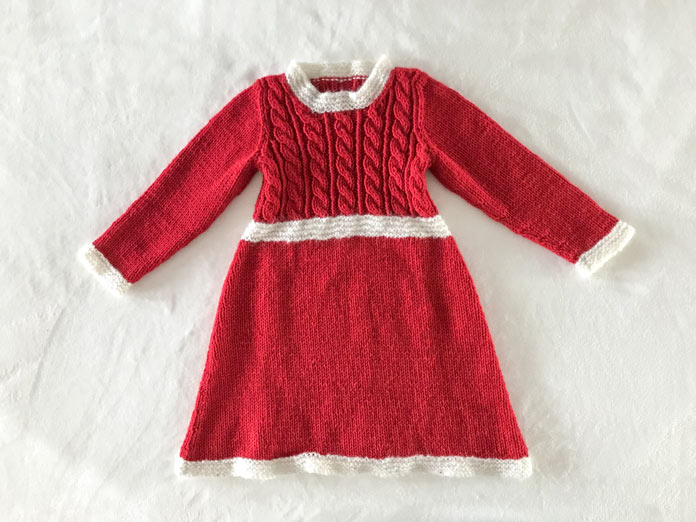 The Cable Sweater Dress, a free pattern by Red Heart modified for the holidays by Cindy O'Malley