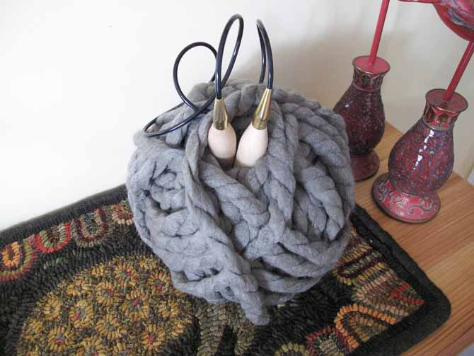 Irresistible yarn in Taupe. When you remove the label the oblong ball takes the shape of a round ball.