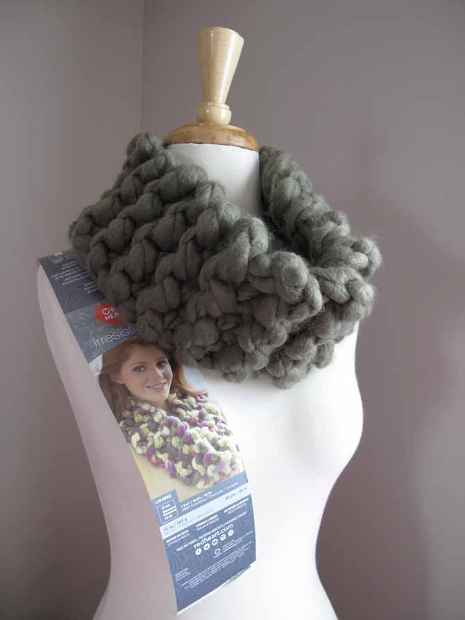 The cowl pattern from the back of the Red Heart's Irresistible yarn label, knit up in Taupe