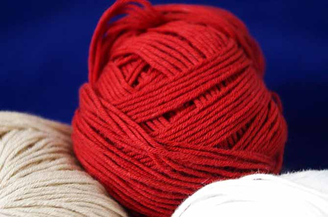 Cotton True Sport. Port Red at the top, beige on the left, and white on the right.
