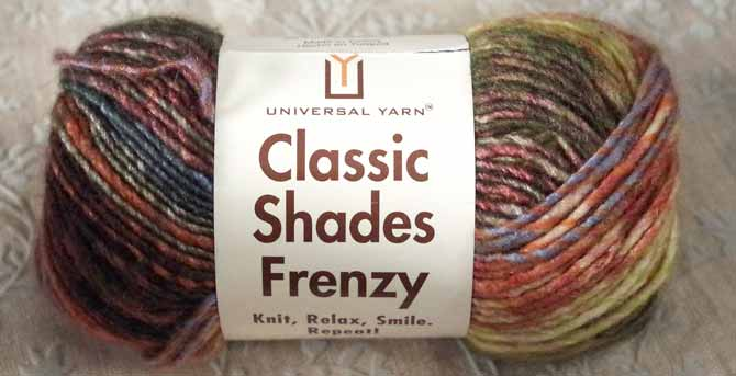 Long-repeat, multicolored chunky yarn Classic Shades Frenzy featuring a fall colorway with rusts, burnt greens, cool blue, and browns that imitate tree bark.