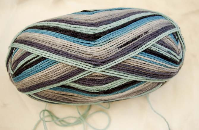 "This Prose colorway called ""Menswear"" makes a great men's sock, but the colors are too exciting to hide inside shoes, so I thought you'd like to see what it looks like knit up in dropped stitch lace."