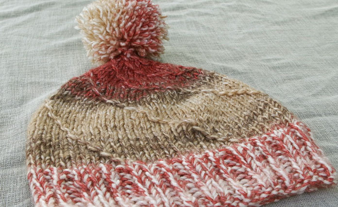 This colorway for this hat is called Russet. I really like the way these warm earth tones blend from light to dark and back again.