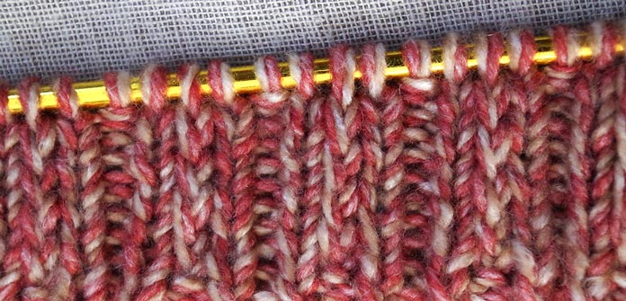Centered twisted and slipped stitches give this 3x1 ribbing a new look and feel.