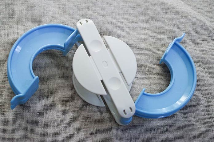 The Clover pompom maker has two halves that each open up to reveal curved arms.