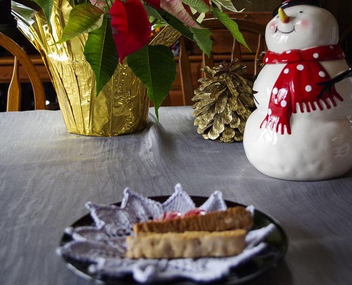 Gluten free biscotti drop a lot of crumbs, but this crumb catcher is just as adept at keeping the holiday table tidy as is this snowman cookie jar.