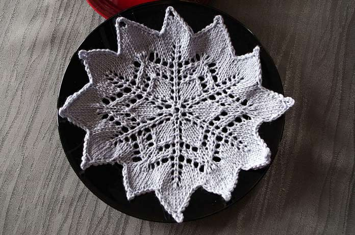 A six-point start ends up as a 12 point snowflake using yarn-over eyelets to create the lacy motif.
