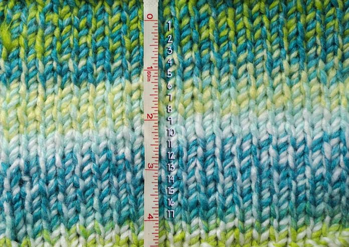 My row gauge is different than the one on the ball band, by a lot, but that doesn't phase me. The look of this self-striping barber pole yarn knit up is stunning.