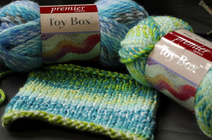 Toy Box in Hula Hoop (on the left) and Wiffle Ball (on the right) is a soft, washable, chunky-weight yarn that is perfect for lots of kids' projects.