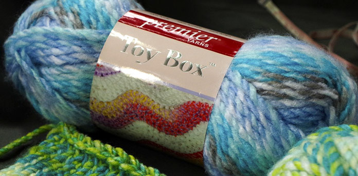 The blues and grays in Toy Box Wiffle Ball, will have you knitting many fun, airy and soft projects.