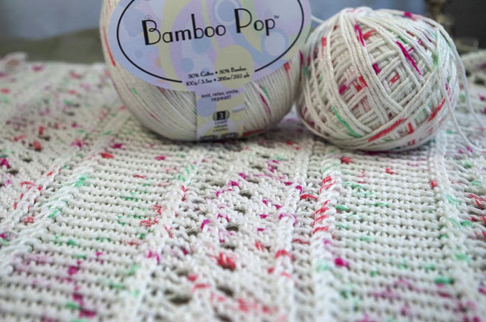 The bamboo fibers in this yarn make the textures truly pop, but the speckles are infrequently placed so they don't deter from either the lace or the twists.