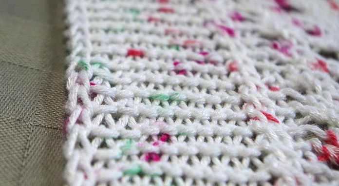 A 2-stitch i-cord edging creates a neat border for the sides of this blanket.
