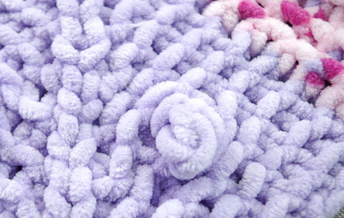 Bobbles look like squishy rosettes and add attractive texture to the blanket.