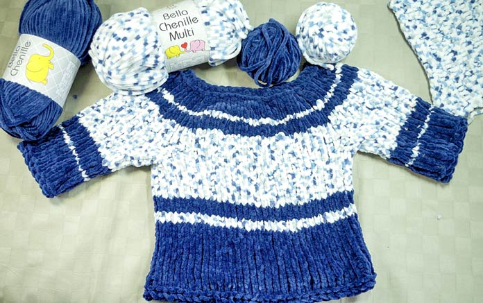 It only took 3/4 of each ball of Bella Chenille to make a size 9 months baby sweater combining a solid blue and a speckled denim colorway.
