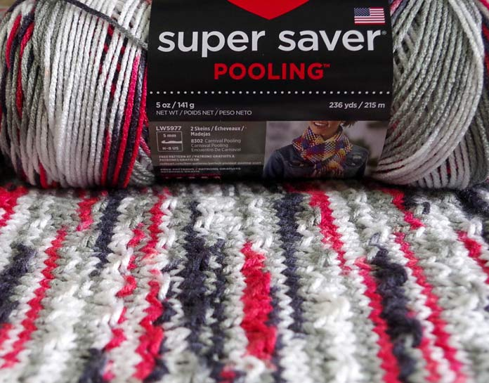 This worsted weight self-striping yarn with short color repeats is perfect for the fleck stitch. Using Red Heart Super Saver Pooling and the fleck stitch to make a knitted swatch.