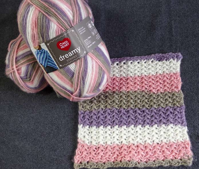The soft purple, gray, pink, and white of this colorway of Red Heart Dreamy Stripes will be perfect for a baby blanket and the bi-directional herringbone stitch will give it a lot of body and warm, and is dense enough to keep out the fingers of the little ones.