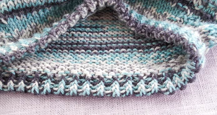 Knitting a rolled ribbing neckline