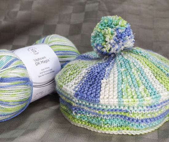 Uptown DK Magix, makes a colorful, warm and soft, and fun-to-wear hat with a beret-style shape.