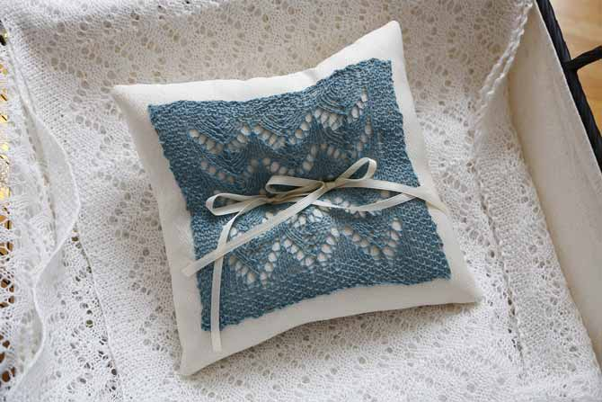 Ring bearer pillow for weddings made with a lace motif on a knitted swatch with 2 ribbons on it using Universal's Flax Lace yarn in mineral