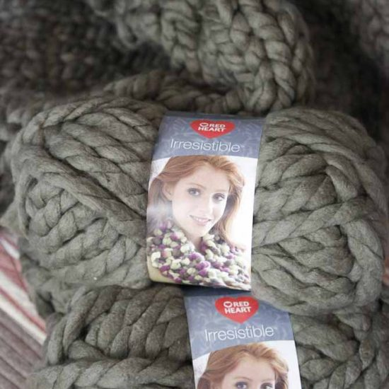 Using Red Heart Boutique Irresistible yarn in Taupe to knit up a 5' x 6' blanket.