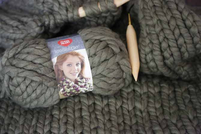 2 balls of Red Heart's Irresistible yarn in Taupe and birch knitting needles - smooth and quick to knit up!