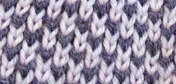 "A close-up of the middle section of my swatch shows how altering the ""worked in the row below"" stitches creates this diagonal shift in the colors."