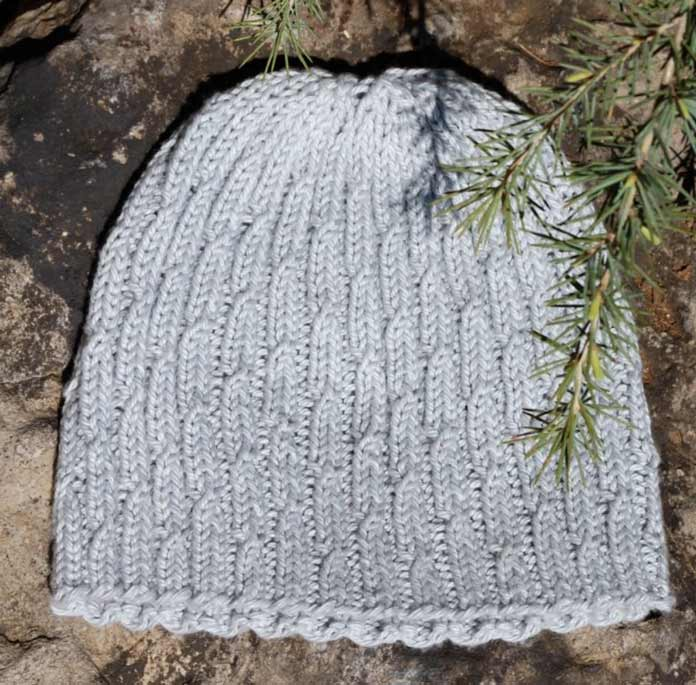 The product photo of the Overcast Cap in a solid grey color. Uptown Worsted Mist is going to be a variegated grey with white. It should look interesting!