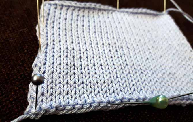 pale periwinkle blue Radian Cotton yarn in a close up of a stockinette swatch