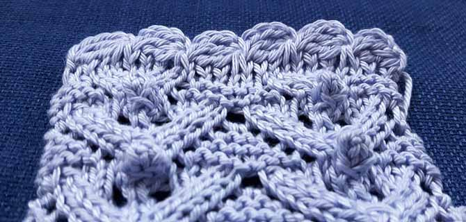 Close up of crocheted scalloped edging from a top-down view