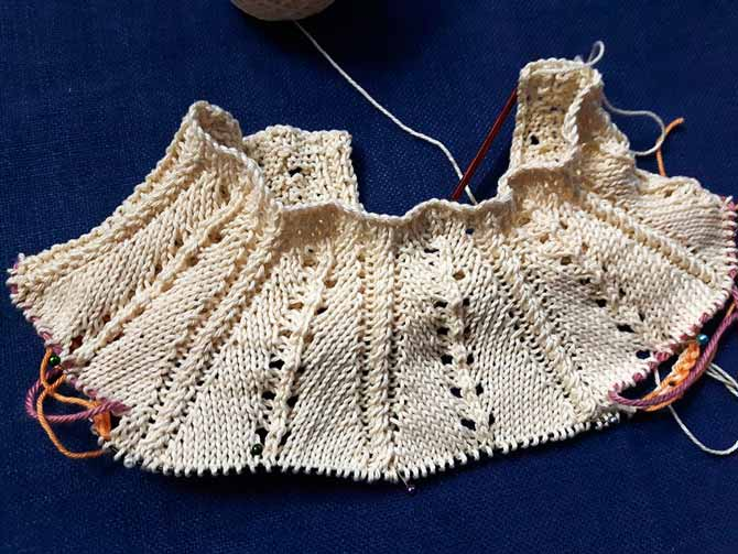 This is a top-down sweater for a toddler featuring centered decreases and sharp, lovely braided cord made of crossed stitches.