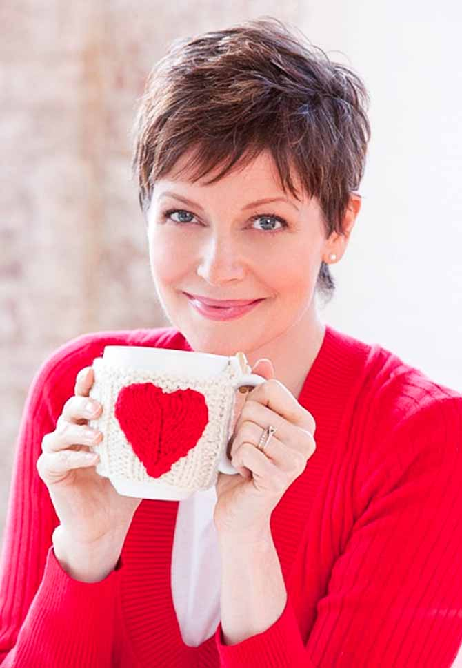 The Valentine's Day Mug Hug pattern by Red Heart! Change the colors up to suit your kitchen, or make it in pink for a friend going through cancer treatment.