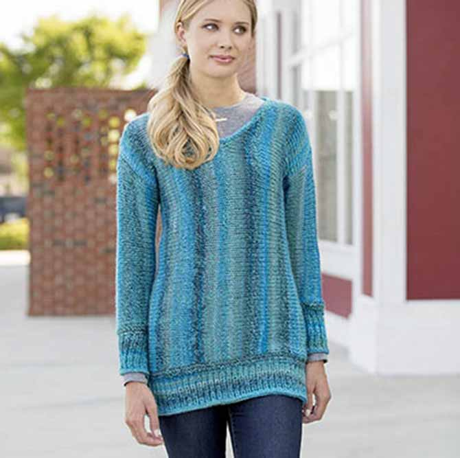"A side-to-side sweater in Frenzy highlights its ""stranded"" gradient colorways in vertical stripes."