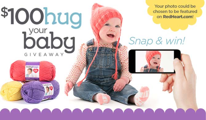 The promo photo for Red Heart's Snap & Win contest. A baby with an orange knitted hat smiling, while someone is taking a photo with a smart phone.