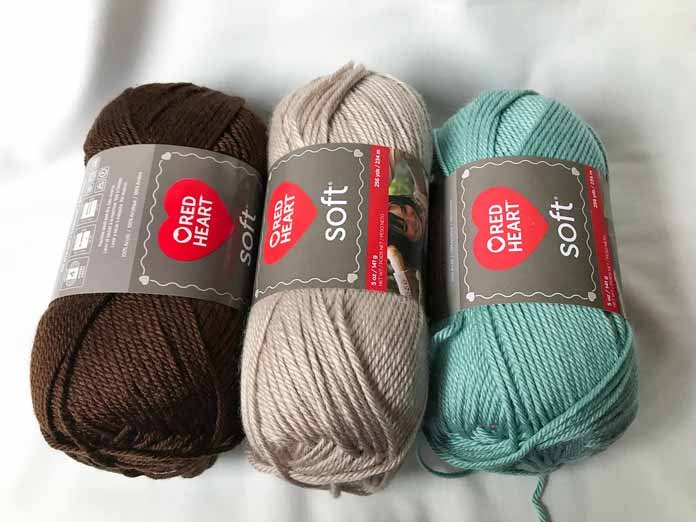 Soft yarn in the colors Chocolate, Biscuit, and Sea Foam.