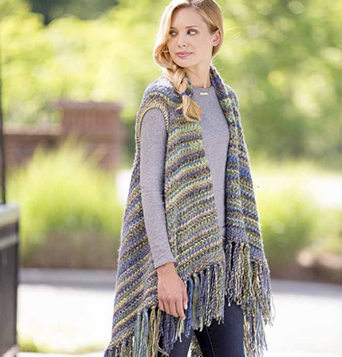 Fringe, twisted stitches, and multicolored yarn make this poncho-style vest an updated classic.
