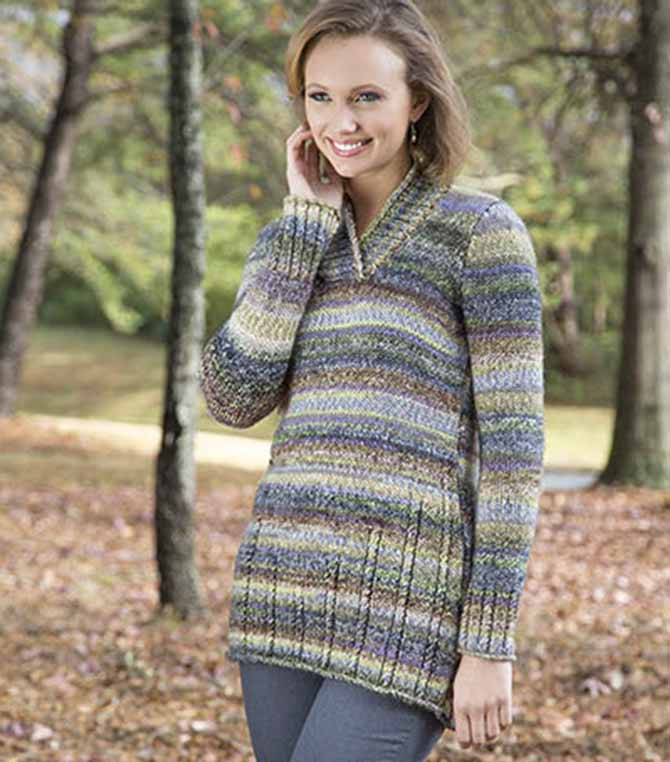 Varying lengths of cables stemming from the hem of the body create movement throughout the sweater.