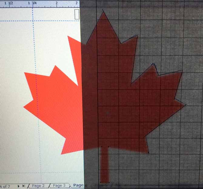 Knitter's graph paper, 22sts and 32 rows to ¼, taped over the right side of the maple leaf of the Canadian flag. The top part has been traced using a pen and ruler, but dots on the lower section can be connected once the paper is removed to minimize any risk of damage.