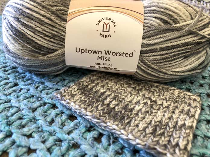 The color Steel Grey with a swatch so you can see how it knits up.