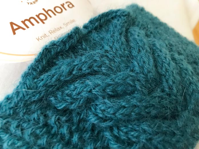 A close up on the cable for the Victory Hat pattern, knit in the lovely color Caspian. When you're blocking the cable, make sure you're blocking it very lightly. If you aggressively block your cable, it will flatten and lose all definition.