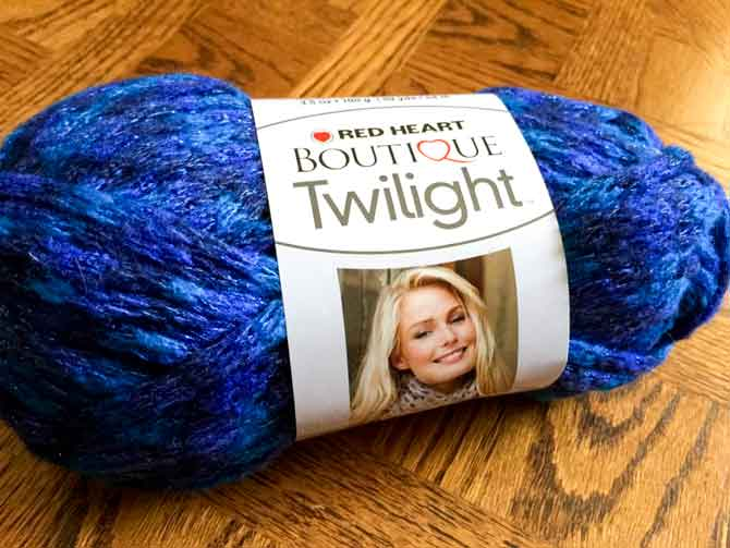 Red Heart Twilight Boutique Yarn...61% Acrylic, 25% Nylon, 9% Polyester and 5% Metallic, perfect for knitting up those holiday gifts!
